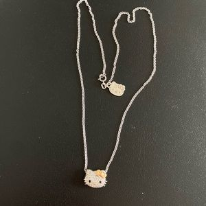 Kimora Lee S. Hello kitty gold diamond necklace.